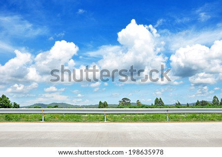 Beautiful roadside view with green nature and blue sky  background - stock photo