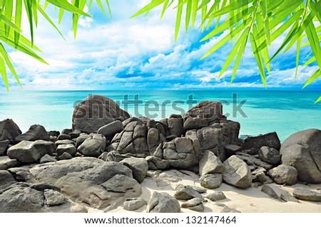 Beautiful rock beach and tropical sea - stock photo