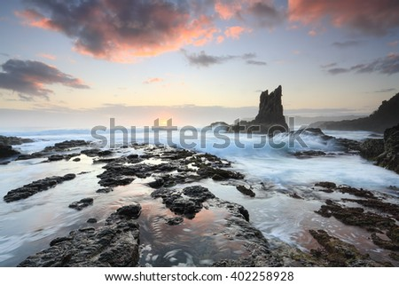 Beautiful rock formations one in the resemblance of a cathedral, and aptly named Cathedral Rock on the south coast near Kiama, Australia, a great place to travel or visit.  Sunrise