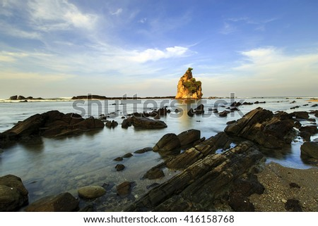beautiful  rock in the ocean,, this is an icon of the beach Sawarna, this icon in the name Tanjung layar ,, this place is located in Ban ten, Indonesia
