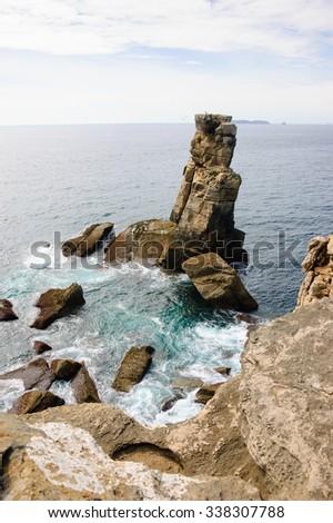 Beautiful rocks in water. Atlantic ocean coast near Peniche (Portugal). - stock photo