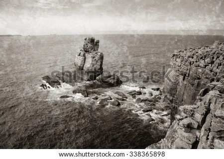 Beautiful rocks in water. Atlantic ocean coast near Peniche (Portugal).  Retro aged photo with scratches. Black and white. - stock photo