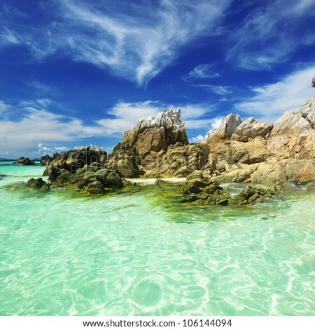 Beautiful rocky beach in thailand - stock photo