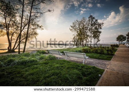 beautiful rocky sea shore at sunrise. Long exposure landscape. Baltic sea in Gdynia Orlowo, Poland. - stock photo