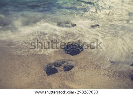 Beautiful rocky sea shore at sunrise or sunset. Long exposure landscape. Crete. - stock photo