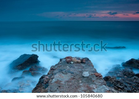 Beautiful rocky seascape with broken pier