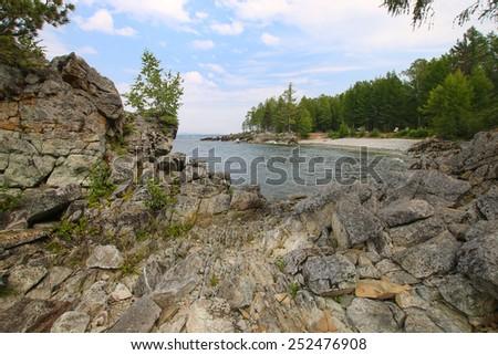 beautiful rocky shore of the lake. Baikal - stock photo