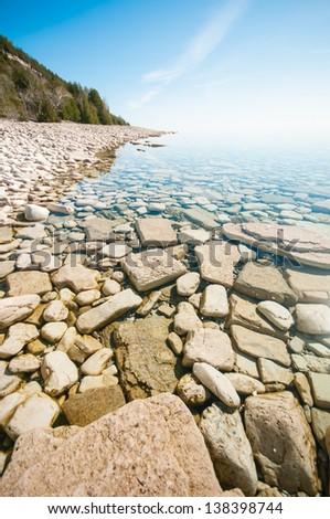 Beautiful rocky shoreline of Georgian Bay, near Tobermory, Bruce Peninsula National Park, Ontario Canada - stock photo