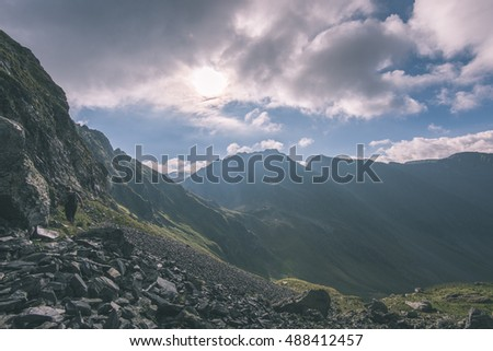 Beautiful rocky view in Fagaras mountains in Southern Carpathians, Romania - vintage film look