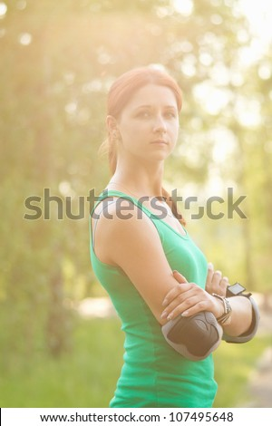 Beautiful roller girl in park - stock photo