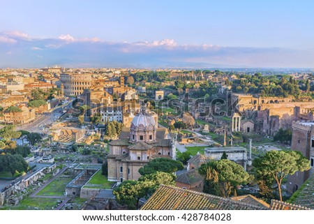 Beautiful Roman Forum, Palatine and Great Colosseum ( Coliseum, Colosseo, Flavian Amphitheatre ) in the evening,at sunset time. Aerial panoramic view on famous touristic landmark. Rome. Italy. Europe. - stock photo