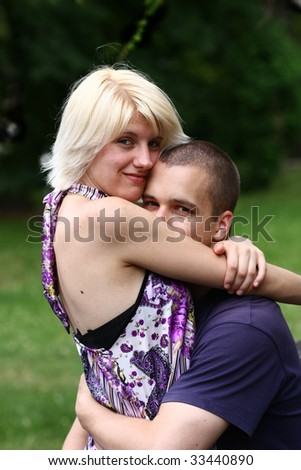 Beautiful romantic couple hugging and smiling outdoors