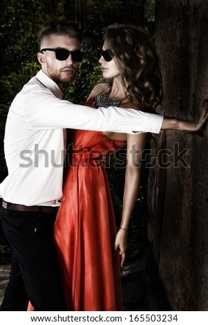 Beautiful romantic couple in love standing outdoor. - stock photo