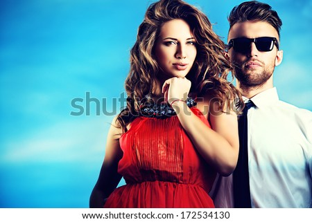 Beautiful romantic couple in love standing over blue sky. - stock photo