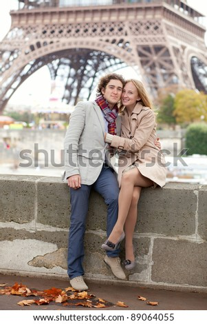 Beautiful romantic couple in Paris near the Eiffel Tower
