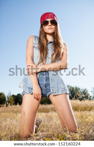 Beautiful romantic girl outdoors. Attractive girl in a summer field. - stock photo