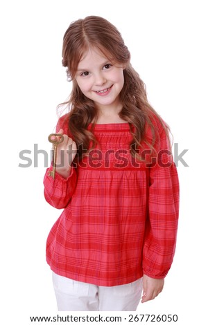 Beautiful romantic little girl holding vintage key/kid and key - stock photo