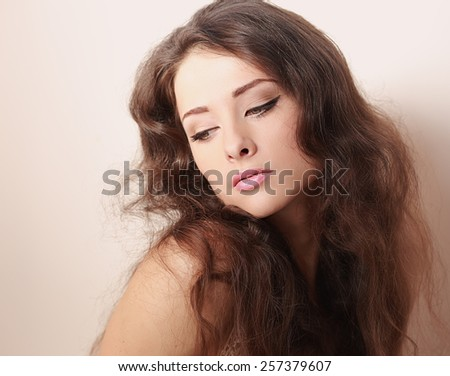Beautiful romantic makeup woman looking down with long hair