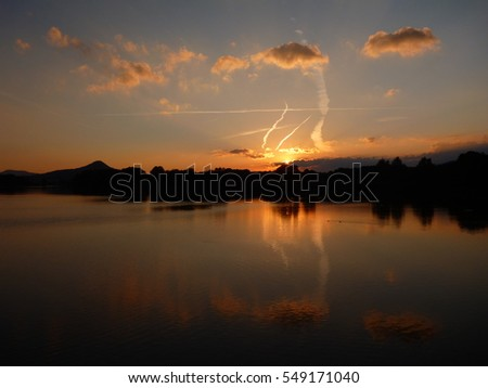 beautiful romantic sunset reflected in a lake water