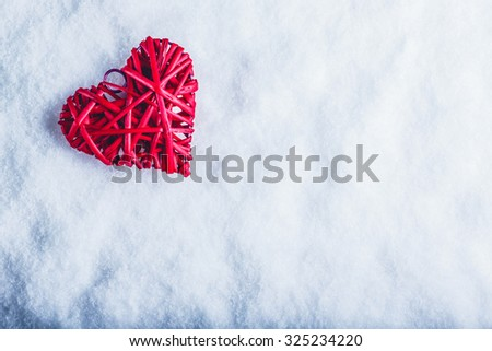 Beautiful romantic vintage red heart on a white snow winter background. Love and St. Valentines Day concept. - stock photo