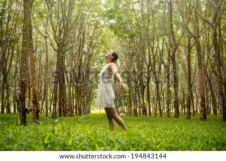 Beautiful romantic woman happy in the forest