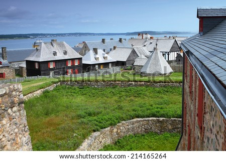 Beautiful roofs of old-fashioned buildings in Fortress of Louisbourg, Nova Scotia, Canada - stock photo