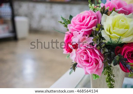 beautiful rose flower on table at coffee shop