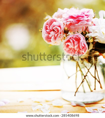Beautiful roses in a vase in vintage style/ Valentines day or mothers day background - stock photo