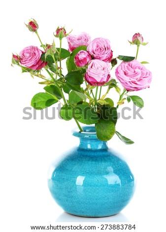 Beautiful roses in vase isolated on white - stock photo