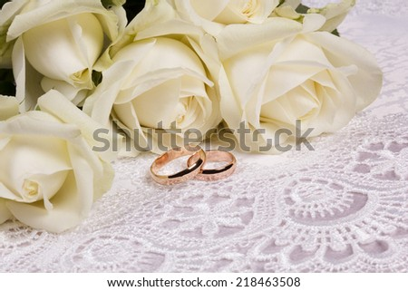 Beautiful roses on a background white silk