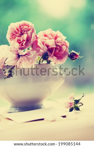 Beautiful roses on desk wooden background/holidays romantic background - stock photo