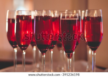 Beautiful row line of different colored alcohol cocktails with mint on a christmas party, martini, vodka,and others on decorated catering bouquet table on open air event, picture with beautiful bokeh - stock photo