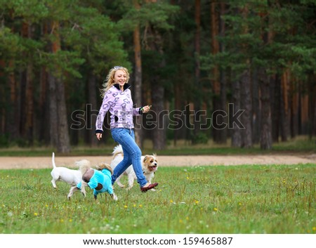 Beautiful  run  woman withyoung dog