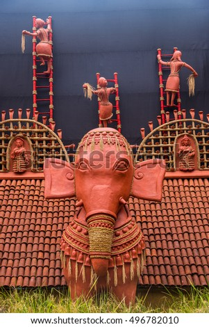 Beautiful rural Indian clay decorations showing villagers harvesting rice and a large elephant in the foreground