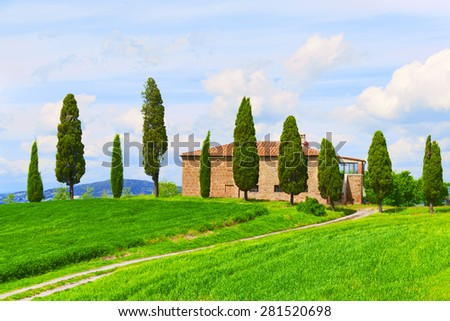 Beautiful rural landscape with the stone house, cypresses and a twisting path, Tuscany, Italy
