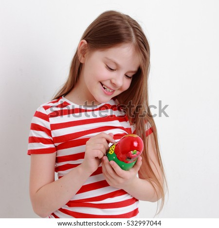 Beautiful russian teen girl holding matryoshka