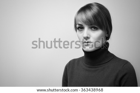 Beautiful sad girl with big blue eyes looking into the camera. Portrait of a Beautiful  girl with sad eyes black and white image - stock photo
