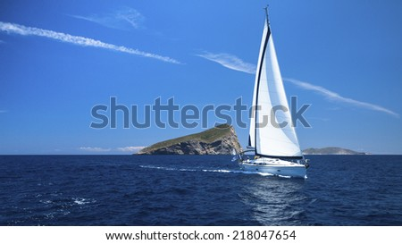 Beautiful sailboat at Sea. Romantic trip luxury yacht. Calm sea Sailing. - stock photo