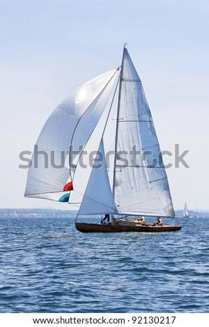 Beautiful sailing ship on the lake - stock photo