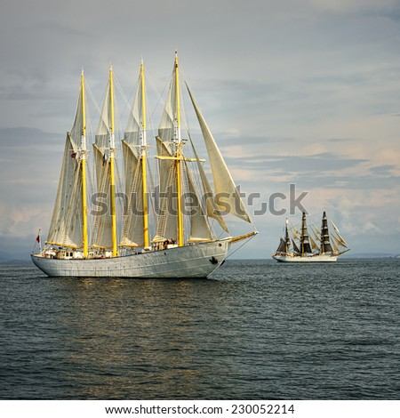 Beautiful sailing ship on the waves. Collection of yachts and ships - stock photo