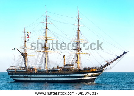 Beautiful sailing vessel in the sea comes into bay