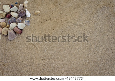 Beautiful sand background with stones. Beach sand background. Sandy texture with stones.. Brown sand. Background from fine sand. Sand background. Summer concept. Top view. Copy space. - stock photo
