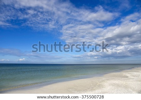 Beautiful Sandy Beach on Anna Maria Island, FL with the Ocean and Sky in the background  - stock photo