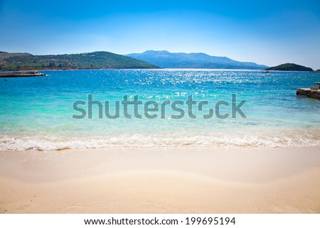 Beautiful sandy Ksamil beach in Albania. - stock photo