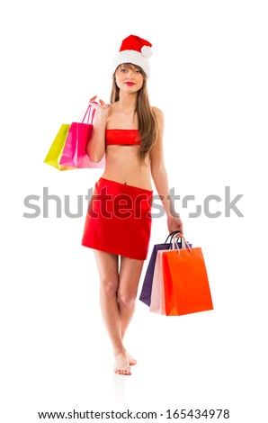 Beautiful Santa christmas girl with shopping bags on white background