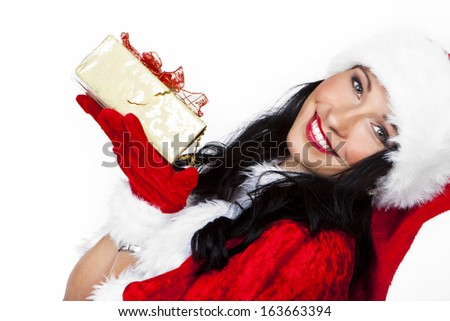 beautiful santa claus woman with christmas gifts  - stock photo