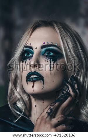 beautiful scaring girl with mystical face art halloween makeupall hallows eve
