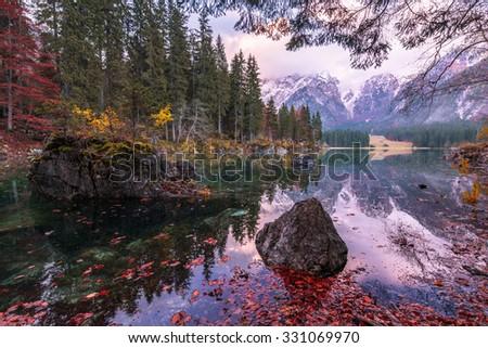 Beautiful scene at lago di Fusine. Autumn scenery at lake Fusine in north Italy in the Alps. - stock photo