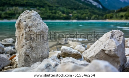 Beautiful scene at Lago di Tenno with crystal clear water and  mountains in the background. Summer scenery at lake Tenno in north Italy - Alps - Europe