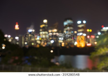 Beautiful scene of colorful bokeh blurred background Sydney city skyline at night - stock photo